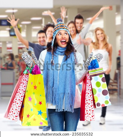 Happy woman with a bags in a shopping center - stock photo