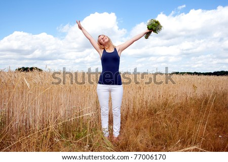 Happy woman with a bunch of flowers - stock photo