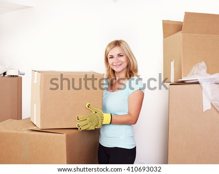 Happy woman with a cardboard box - stock photo