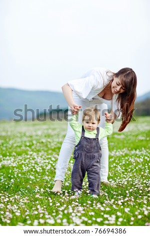 Happy woman with a child resting on the nature - stock photo