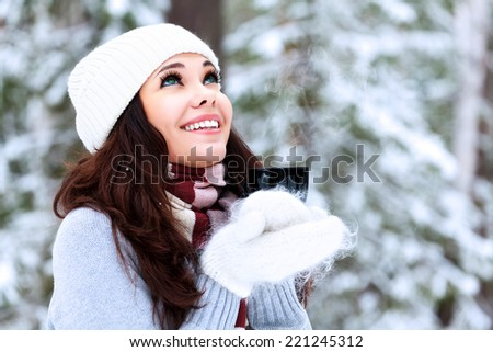 Happy woman with a cup of hot tea  - stock photo
