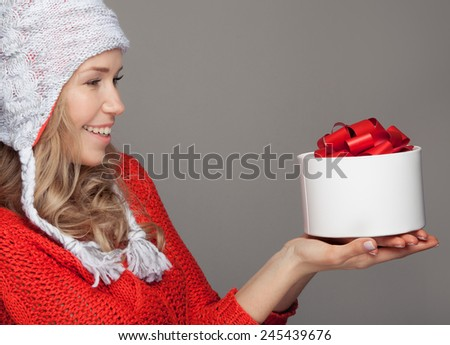 Happy woman with a gift. Holidays. - stock photo