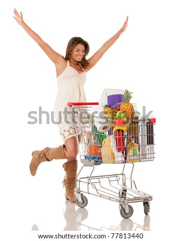 Happy woman with a shopping cart buying groceries - isolated over white - stock photo