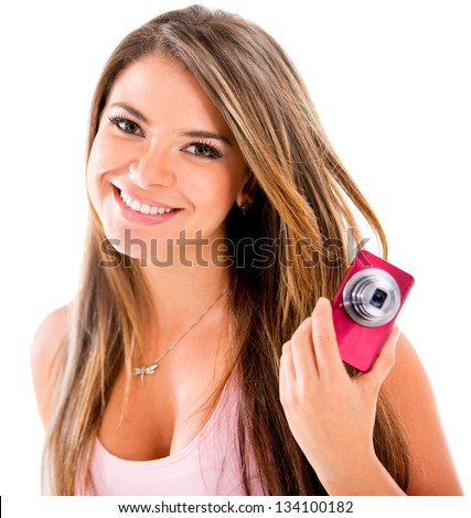 Happy woman with a small digital camera - isolated over white - stock photo