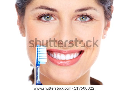 Happy woman with a toothbrush. Dental care. Isolated on white background. - stock photo