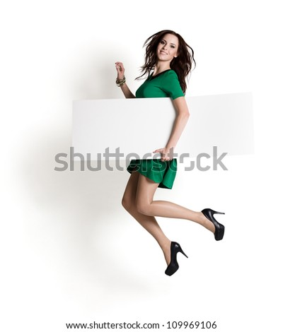 Happy woman with blank board - stock photo