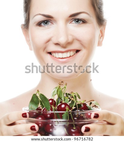 happy  woman with cherries over white - stock photo