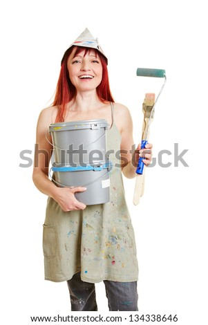 Happy woman with different paint buckets and brush - stock photo