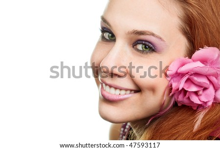 Happy woman with flower at ear isolated on white background - stock photo