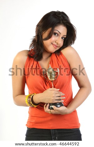 Happy woman with gold trophy - stock photo