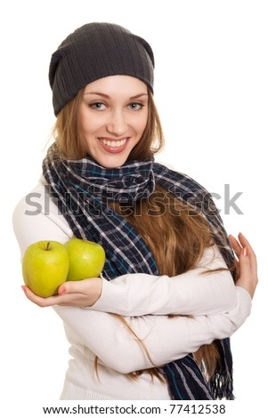Happy woman with green apple on white background - stock photo