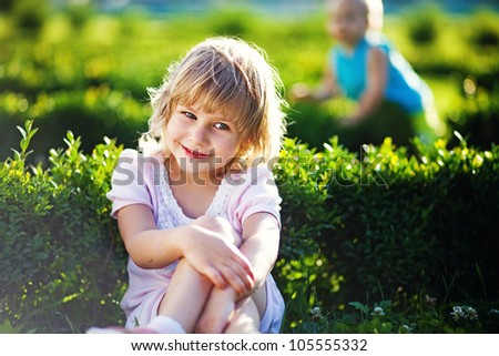 Happy woman with kids outdoors - stock photo