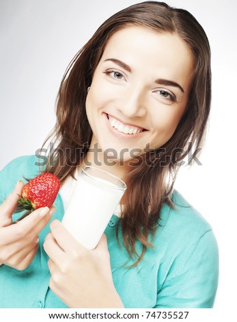 happy woman with milk and strawberry - stock photo