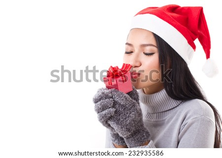 happy woman with red gift box and christmas santa hat - stock photo
