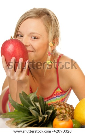 Happy woman with ripe mango and other tropical fruits - stock photo