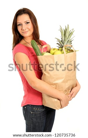 Happy woman with shopping bags and groceries - stock photo