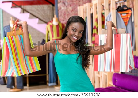 Happy woman with shopping bags in a mall