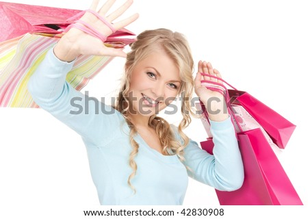 happy woman with shopping bags over white - stock photo