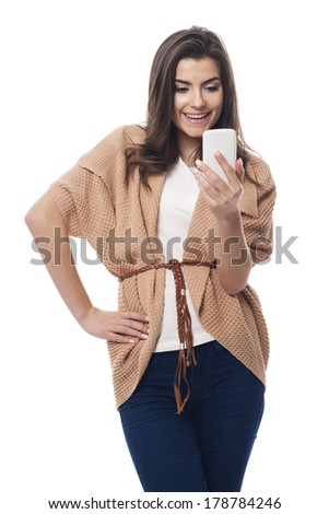 Happy woman with white mobile phone  - stock photo