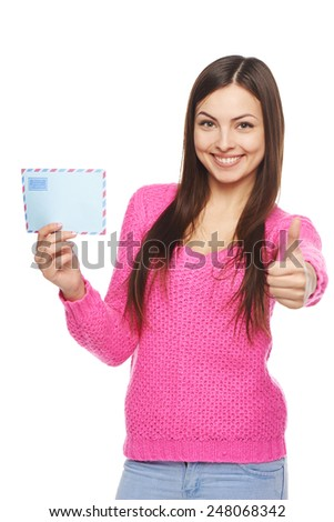 Happy womanshowing air mail envelope and giving approving sign, over white background - stock photo