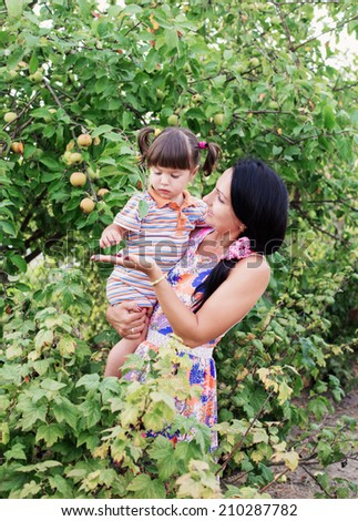 happy women and little child with berries