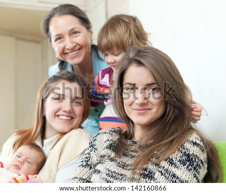 Happy women of three generations in home interior - stock photo