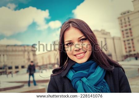 Happy women smiling headshot. Women in blue scarf posing outdoors. - stock photo
