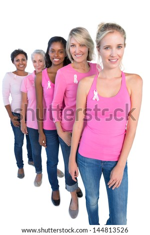 Happy women wearing pink and ribbons for breast cancer on white background - stock photo