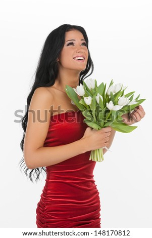Happy women with flowers. Attractive young woman holding a bunch of flowers while standing against white background