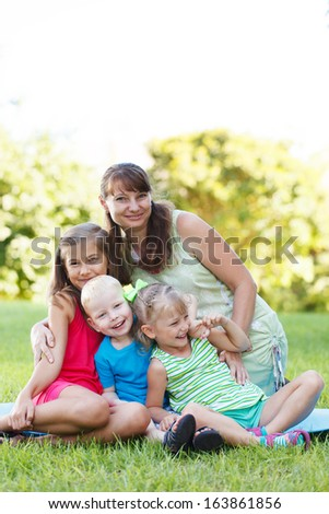 Happy women with her children outside - stock photo