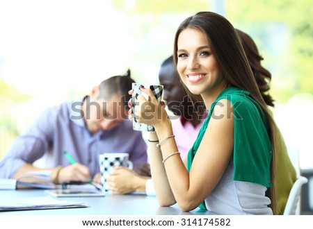 Happy work team during break time in office - stock photo