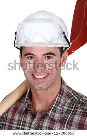Happy worker with spade - stock photo