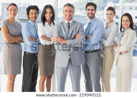 Happy workers standing all together in the workplace - stock photo