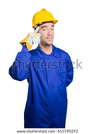 Happy workman with concentration gesture on white background