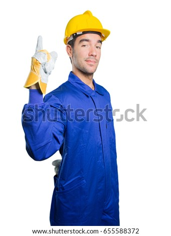 Happy workman with number one gesture on white background