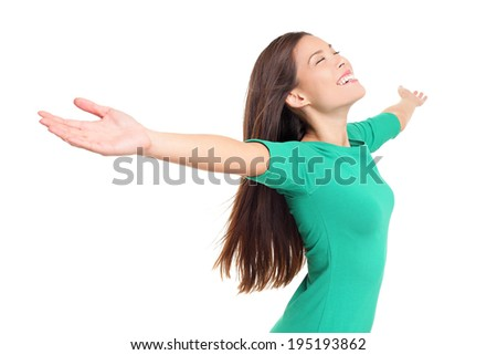 Happy worshipping praising joyful elated woman with arms raised outstretched smiling joyful and ecstatic full of happiness with eyes closed isolated on white background in studio. Mixed race female. - stock photo