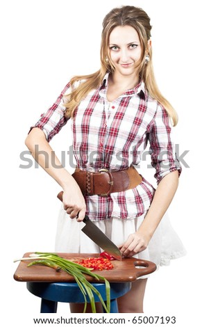 happy yang woman cutting vegetables for a salad isolated on white - stock photo