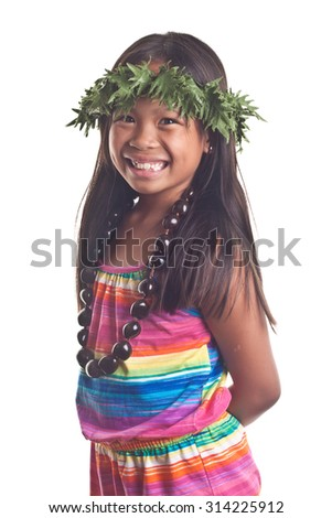 Happy 7 year old Hawaiian Girl with an full smile      Image isolated on white