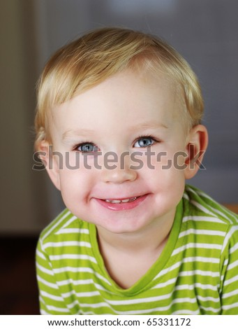 Happy 2 years old baby boy. Kid is smiling, grinning. - stock photo