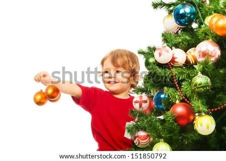 Happy 3 years old boy holding Charismas balls decoration - stock photo