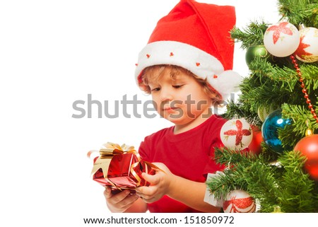 Happy 3 years old boy with little red present box - stock photo