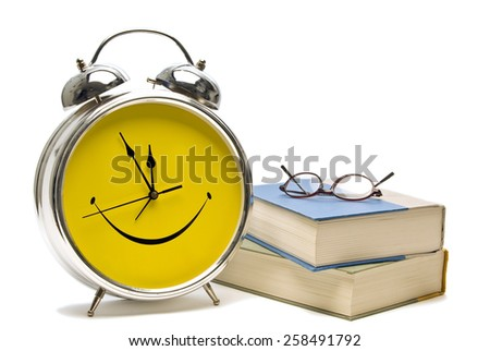 Happy Yellow Alarm Clock With Books And Glasses/ Time For School - stock photo