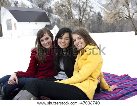 Happy Young Adults in Winter - stock photo