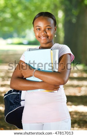 happy young african american college student on campus - stock photo