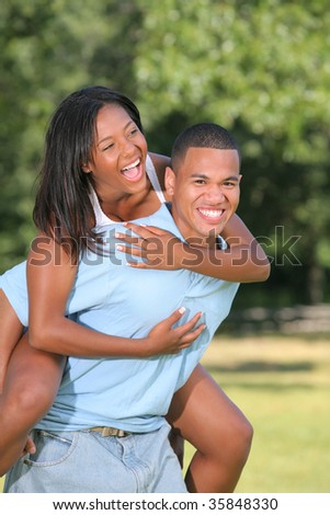 Happy Young African American Couple Laughing Outdoor in Summer - stock photo