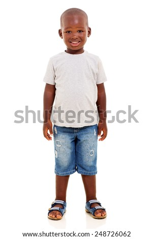 happy young african boy standing on white background - stock photo