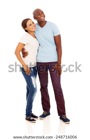 happy young african couple looking up isolated on white background - stock photo