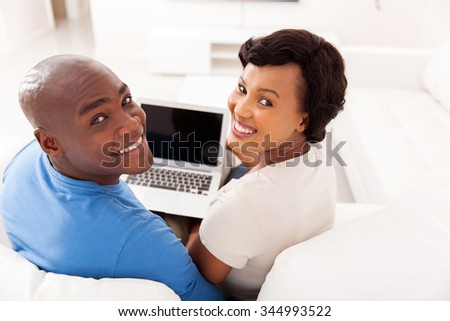 happy young african couple with laptop computer - stock photo