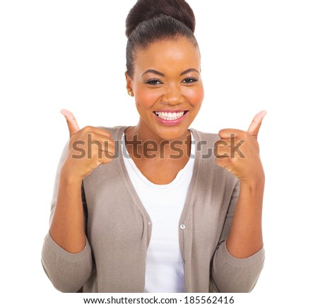 happy young african girl showing thumbs up on white background - stock photo