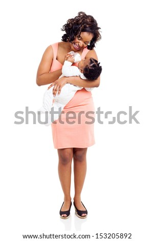 happy young african mother feeding her baby isolated on white - stock photo